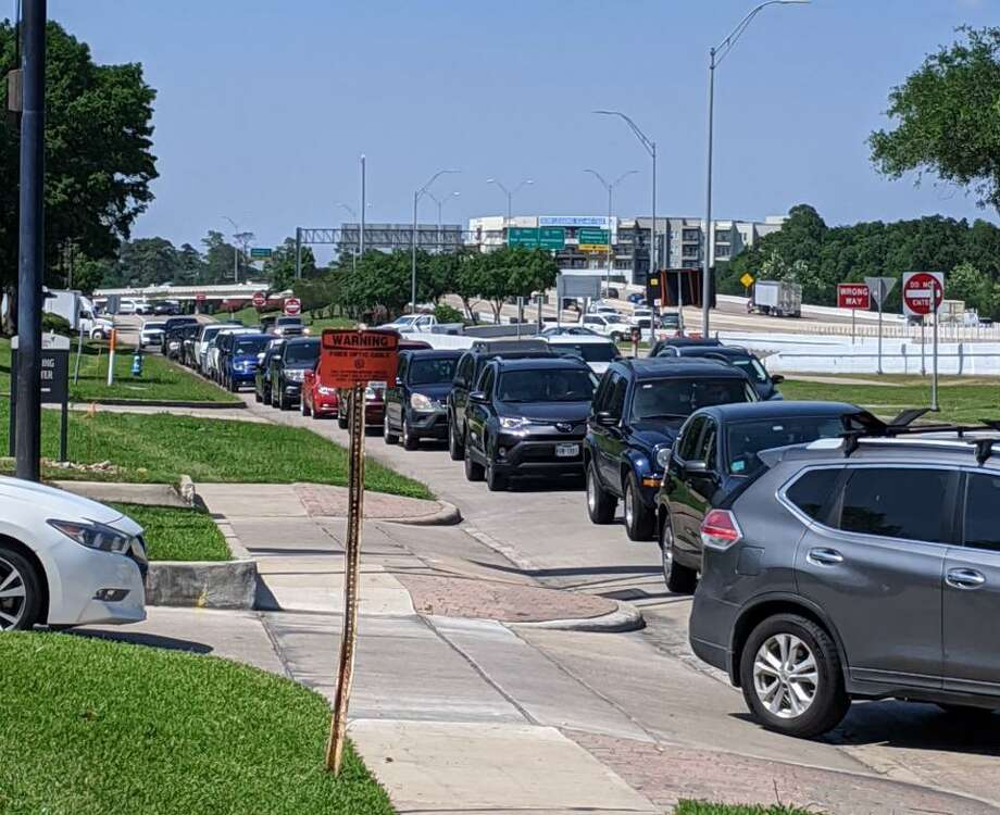 Cars are lined up along West Beltway 8 South on Tuesday, April 21, 2020, for food distribution at Revere Middle School at 10502 Briar Forest Dr. Photo: Roy Kent / Staff Photo