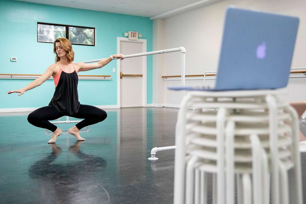 Renee Moran, co-owner of the children performing arts center Performing Academy, practices moves and curriculum for her virtual dance class while at her empty dance studio in Pleasant Hill, Calif. Tuesday, April 21, 2020. To increase odds of approval for the federal government's Paycheck Protection Program for her small business, Moran applied to Wells Fargo and First Bank, banks she's been in business with for years. If she gets approved at one, she planned to cancel the other, she said. But the federal aid ran out before she could plan her move.
