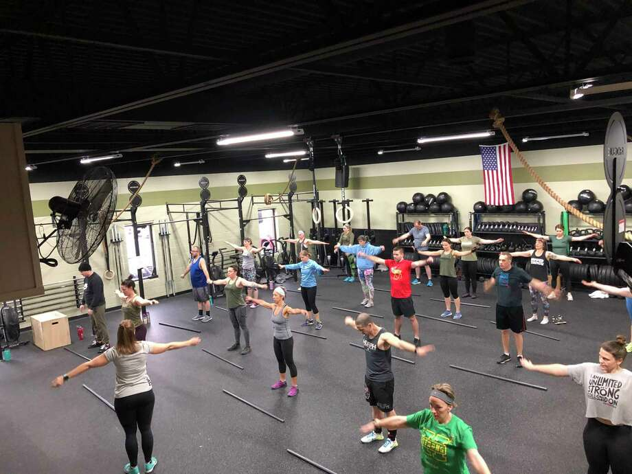 Members of Midland's CrossFit Jack Pine participating in a work before the gym was forced to shut its doors during the state's stay home order. (Photo provided)