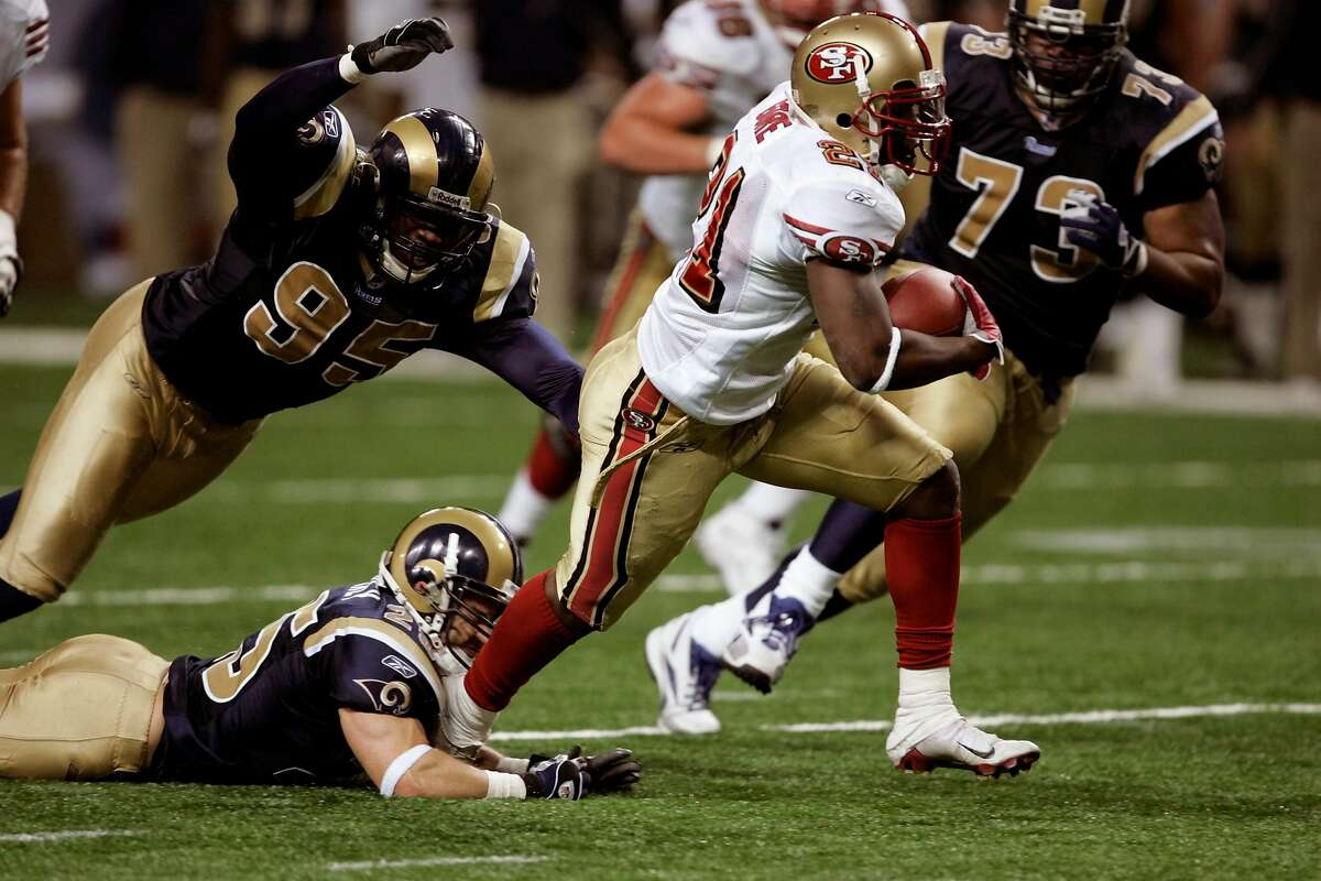 49ers_018_CAG.JPG 49ers Frank Gore breaks several tackles and finds his way into the end zone for the game-winning touchdown in the fourth quarter of play on a 30-yard run. The San Francisco 49ers played the St. Louis Rams at Edward Jones Dome in St. Louis, Mo., on Saturday, December 24, 2005. The 49ers defeated the Rams 24-20. Photo by Carlos Avila Gonzalez / The San Francisco Chronicle Photo taken on 12/24/05 in St. Louis, MO. Ran on: 12-25-2005 Frank Gore breaks several tackles and leaves Rams safety Mike Furrey with a taste of shoe leather on his way to the game-winning TD. Ran on: 12-25-2005 Frank Gore breaks several tackles and leaves Rams safety Mike Furrey with a taste of shoe leather on his way to the game-winning TD.