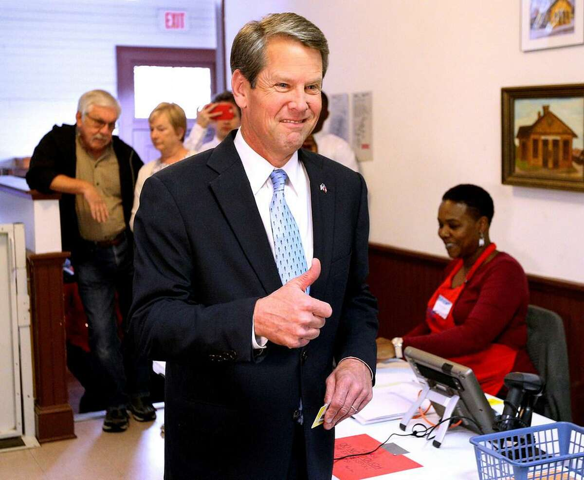 Brian Kemp gives the thumbs up as he arrives to cast his vote at the Winterville Train Depot on Tuesday, Nov. 6, 2018, in Winterville, Ga.