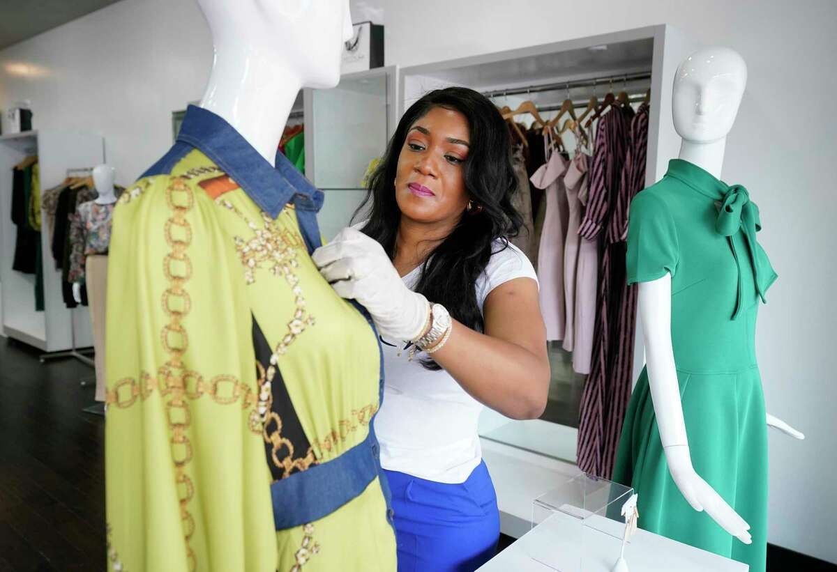Ebele Iloanya, MODChic Couture boutique owner and designer, prepares her Sugar Land Town Square store to open as retail-to-go stores this Friday amid the COVID-19 pandemic.