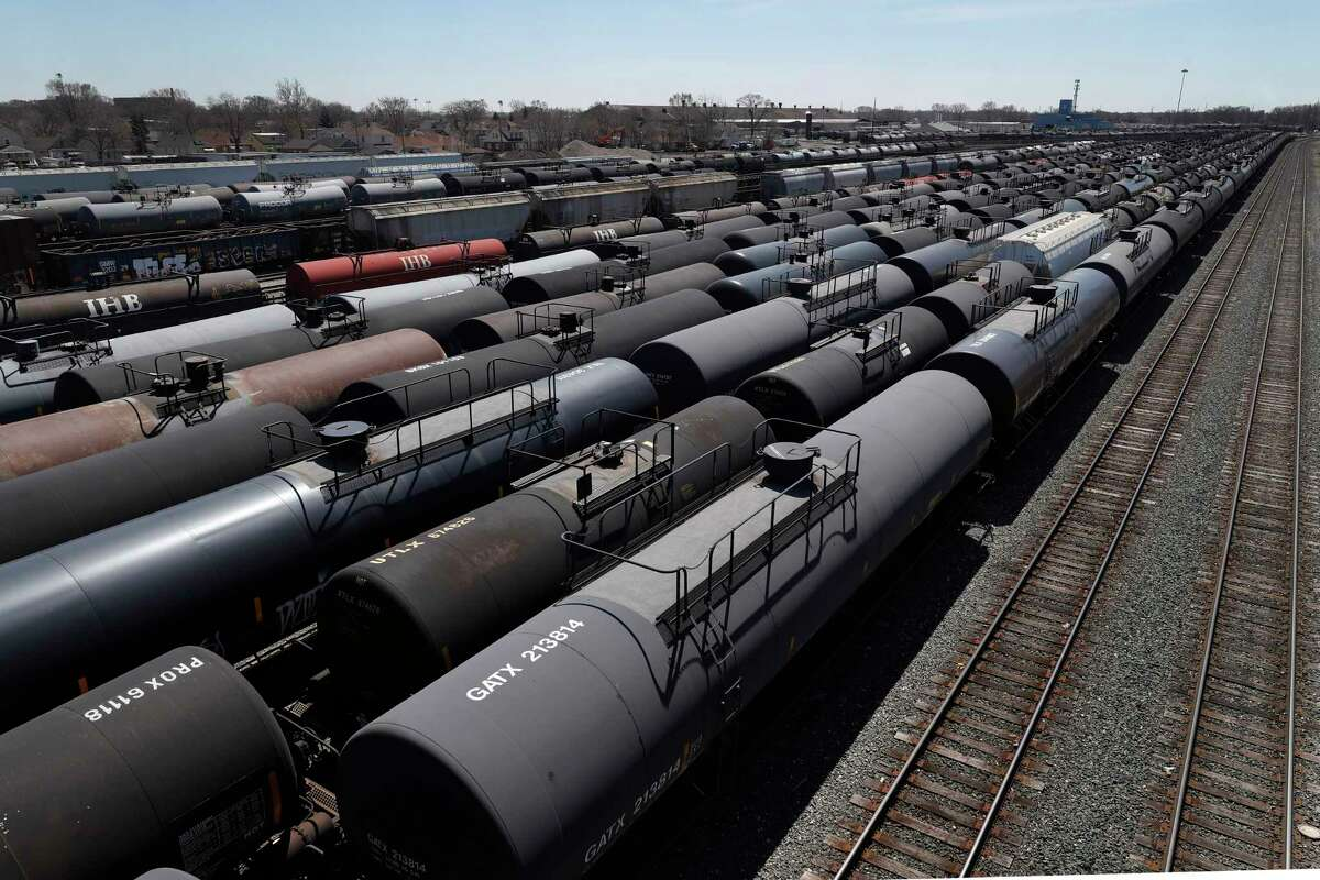 Oil tank train cars sit idle Tuesday, April 21, 2020, in East Chicago, Ind. The world is awash in oil, there's little demand for it and we're running out of places to put it. That in a nutshell explains this week's strange and unprecedented action in the market for crude oil futures contracts, where traders essentially offered to pay someone else to deal with the oil they were due to have delivered next month. (AP Photo/Charles Rex Arbogast)