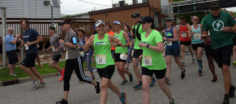 Kim Hood of Glen Carbon, (#22), signals her approval during a previous Metro Milers race. Photo: Courtesy Of The Metro Milers Club