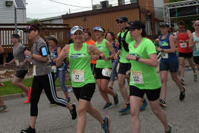 Kim Hood of Glen Carbon, (#22), signals her approval during a previous Metro Milers race.