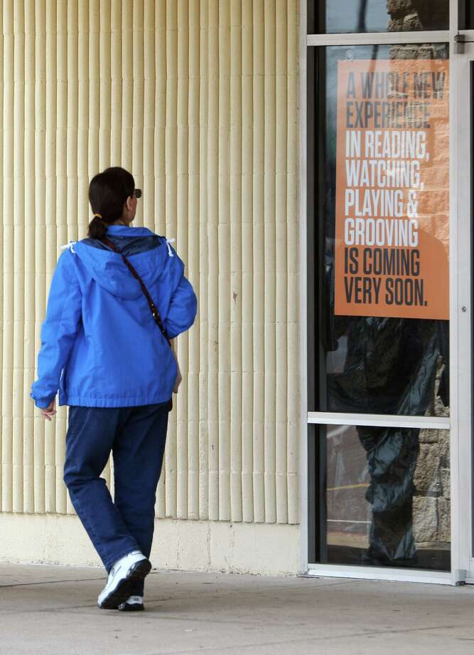 A woman reads a sign in the window of the Books-A-Million at Parkdale Mall on Monday afternoon. The bookstore has shut its doors, if temporarily. An employee said the store will be shut down until May. Photo taken Monday, 3/10/14 Jake Daniels/@JakeD_in_SETX Photo: Jake Daniels / ©2014 The Beaumont Enterprise/Jake Daniels