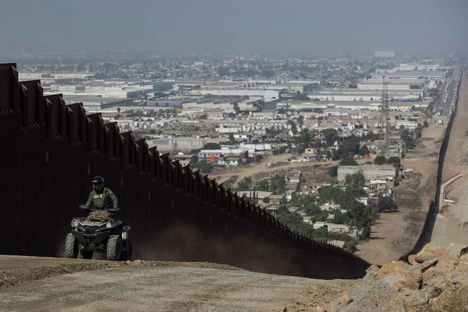 A U.S. Border Patrol agent drives along a construction site for the secondary border fence, which follows the length of the primary border fence that separates the United States and Mexico in in San Diego, in August 2019. Photo: Washington Post Photo By Carolyn Van Houten / The Washington Post
