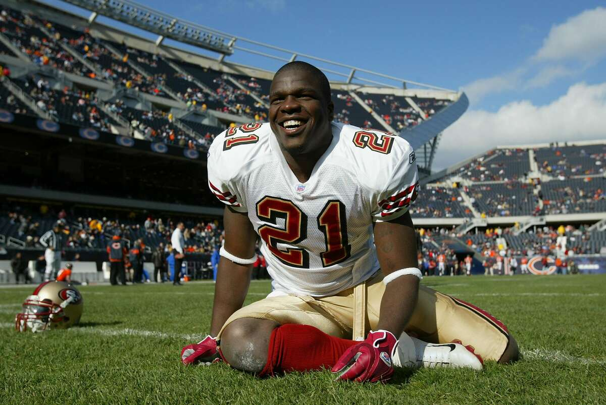 CHICAGO - NOVEMBER 13: Frank Gore #21 of the San Francisco 49ers stretches before the game against the Chicago Bears on November 13, 2005 at Soldier Field in Chicago, Illinois. The Bears defeated the 49ers 17-9. ~~