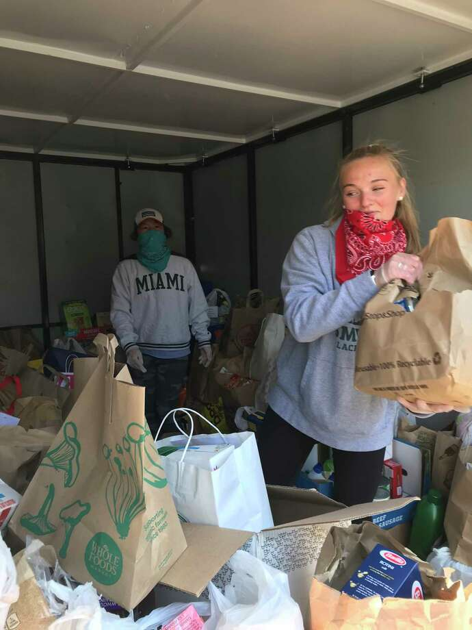 Volunteers storing donations at the April 19 food and goods drive. Photo: / Alexis Harrison