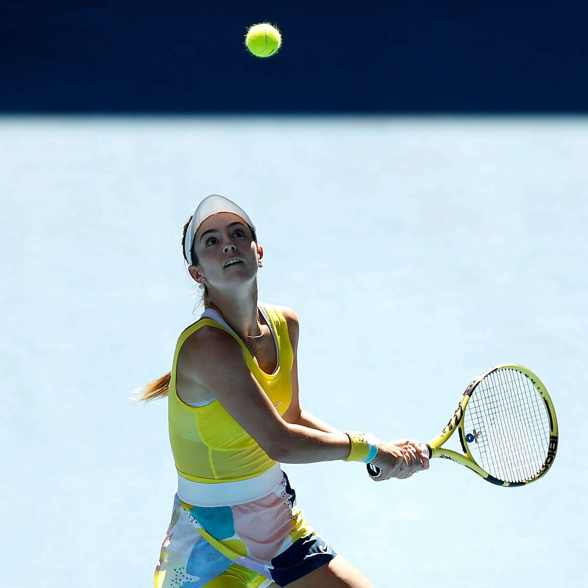 MELBOURNE, AUSTRALIA - JANUARY 25: Catherine Bellis of the Unites States plays a backhand during her Women's Singles third round match against Elise Mertens of Belgium on day six of the 2020 Australian Open at Melbourne Park on January 25, 2020 in Melbou