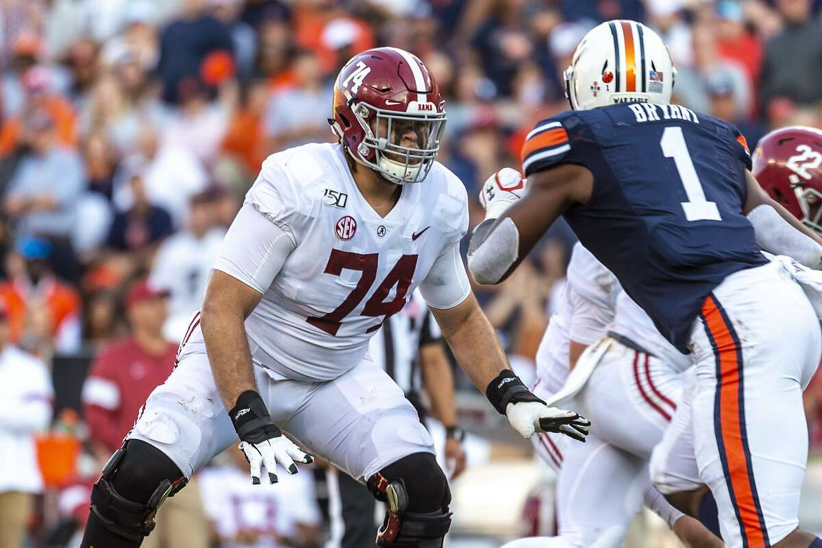FILE - In this Nov. 30, 2019, file photo, Alabama offensive lineman Jedrick Wills Jr. (74) sets up to block against Auburn defensive lineman Big Kat Bryant (1) during the first half of an NCAA college football game in Auburn, Ala. Wills is a likely first-round pick in the NFL draft Thursday, April 23, 2020. (AP Photo/Vasha Hunt, File)