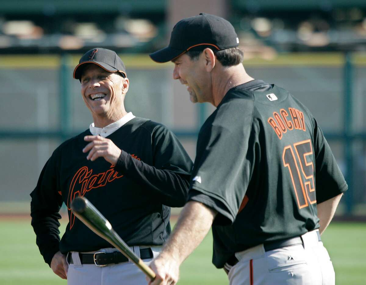 San Francisco Giants' new manager Bruce Bochy, right, laughs with new coach Tim Flannery, left, during a spring training baseball workout at Scottsdale Stadium in Scottsdale, Ariz., Thursday, Feb. 15, 2007. Bochy and Flannery last worked together for the San Diego Padres. (AP Photo/Eric Risberg) Ran on: 02-18-2007 Bruce Bochy (right, with coach Tim Flannery) hopes to still be laughing at the end of the 2007 baseball season.