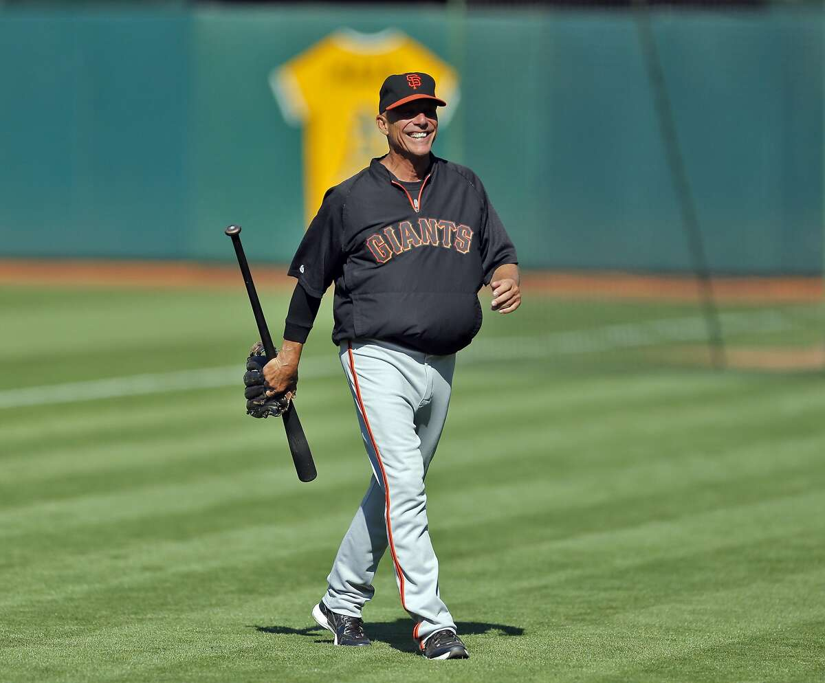 Giants third base coach Tim Flannery smiles during warm ups on Tuesday, July 8, 2014 at O.co Coliseum in Oakland, Calif. A's third base coach Mike Gallego, and Giants third base coach Tim Flannery are close friends off the field, and share some successful traits in their coaching style. Both coaches were in opposing dugouts when the A's hosted the Giants