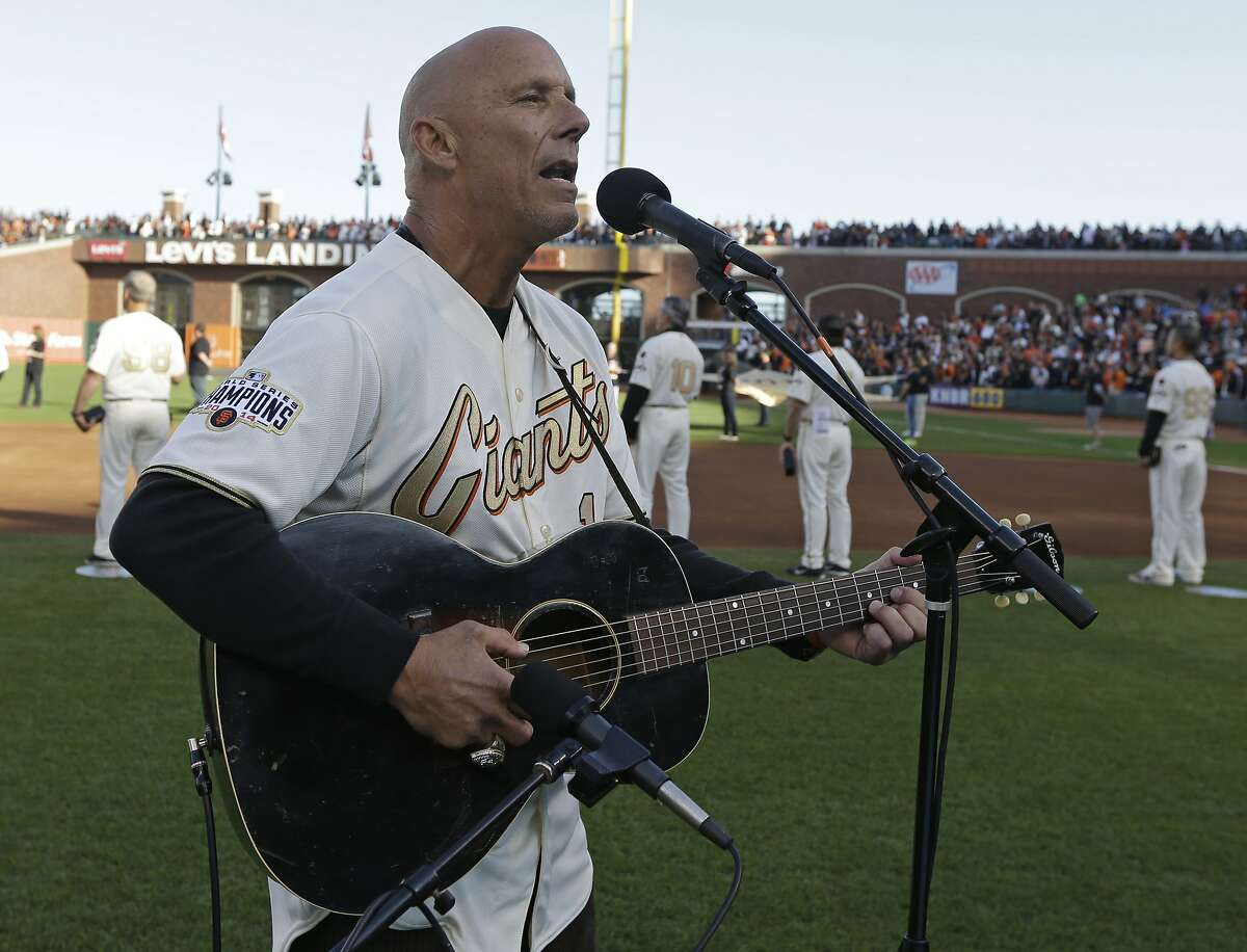 Former San Francisco Giants third base coach Tim Flannery performs the national anthem prior to the Giants' game against the Arizona Diamondbacks on April 18, 2015, in San Francisco.