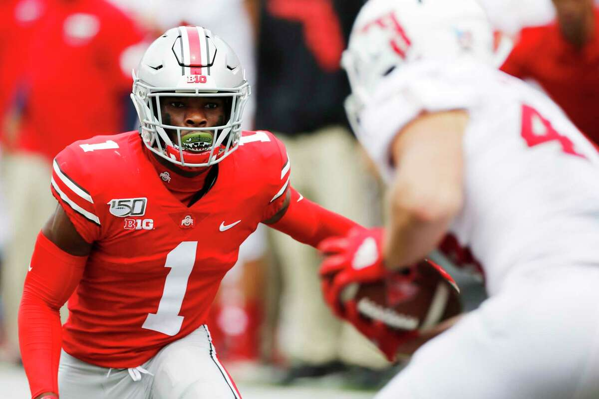 FILE - In this Aug. 31, 2019, file photo, Ohio State defensive back Jeff Okudah watches a Florida Atlantic player duirng an NCAA college football game in Columbus, Ohio. Okudah is the top player at cornerback heading into the NFL draft. (AP Photo/Jay LaPrete, File)