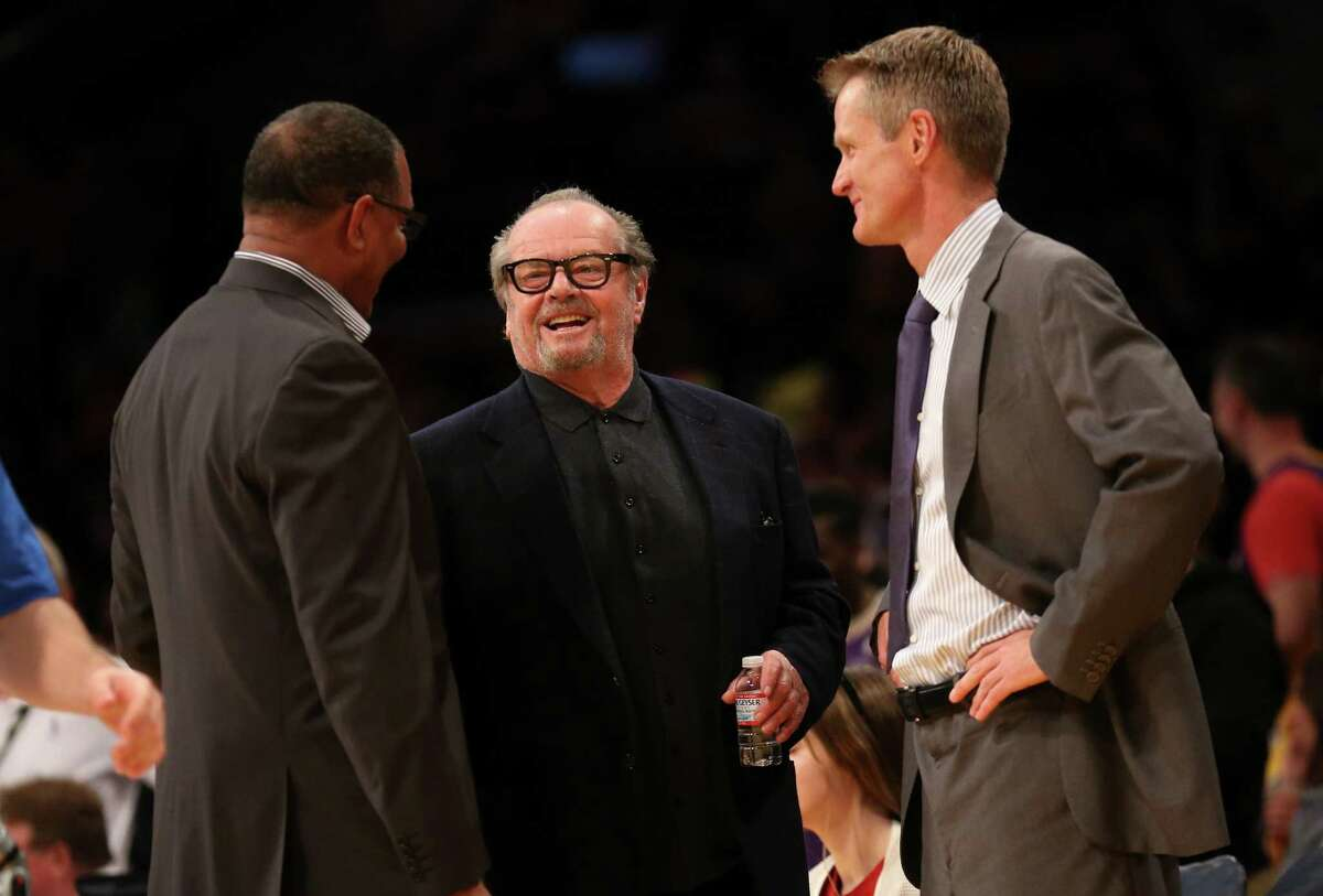 LOS ANGELES, CA - NOVEMBER 16: Actor Jack Nicholson (C) talks with head coach Steve Kerr (R) and assistant coach Alvin Gentry of the Golden State Warriors before the game with the Los Angeles Lakers at Staples Center on November 16, 2014 in Los Angeles, California. The Warriors won 136-115. NOTE TO USER: User expressly acknowledges and agrees that, by downloading and or using this photograph, User is consenting to the terms and conditions of the Getty Images License Agreement. (Photo by Stephen Dunn/Getty Images) ORG XMIT: 508084435
