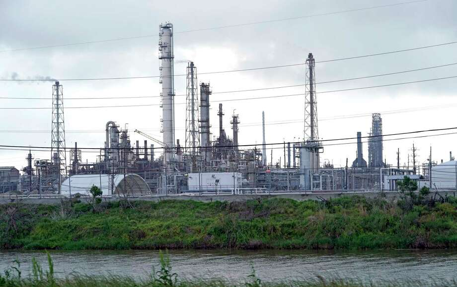 The Motiva refinery, the largest oil refinery in North America, is shown Monday, March 23, 2020, in Port Arthur, Texas. The Texas Gulf Coast is the United States' petrochemical corridor, with four of the country's 10 biggest oil and gas refineries and thousands of chemical facilities. (AP Photo/David J. Phillip) Photo: David J. Phillip, STF / Associated Press / Copyright 2020 The Associated Press. All rights reserved.