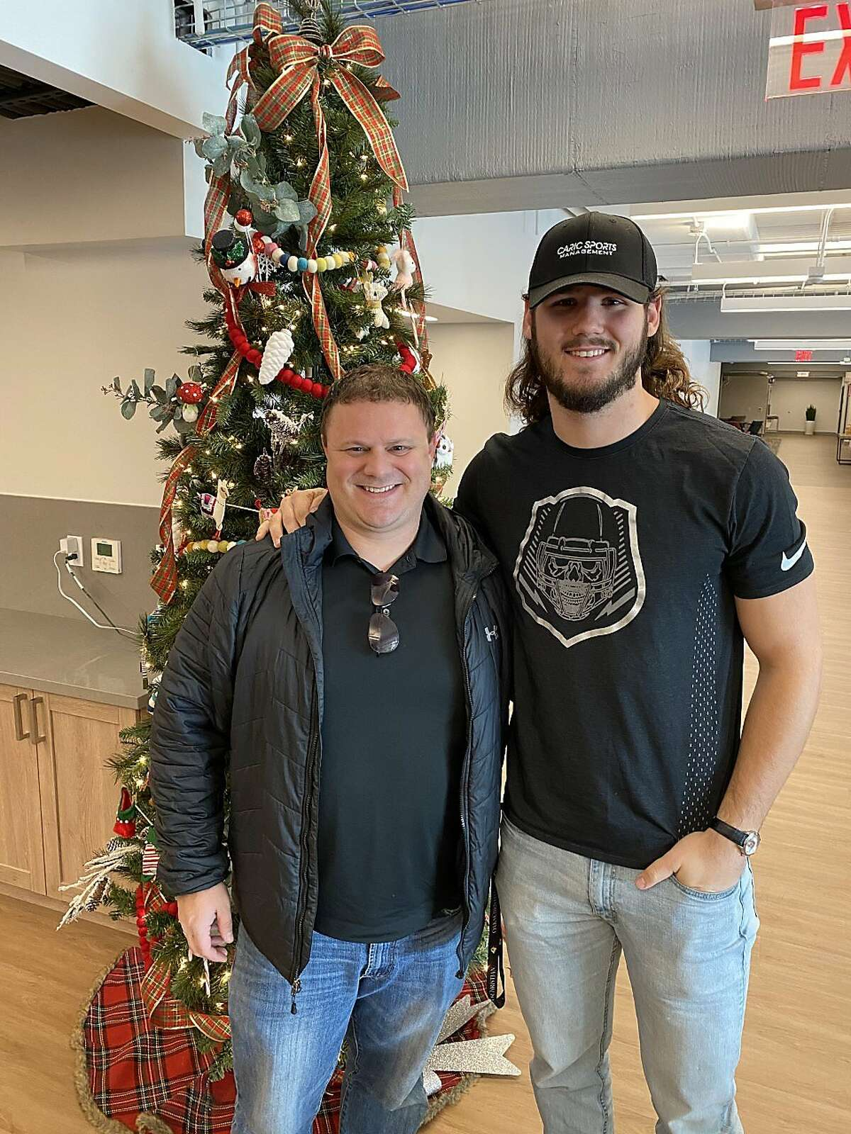 Agent Steve Caric (left) and his client, Stanford tight end Colby Parkinson.