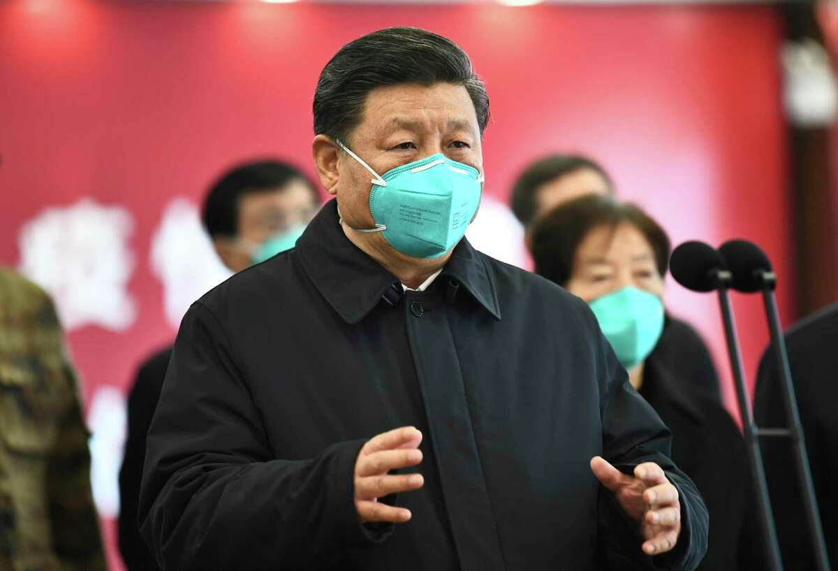 FILE - In this March 10, 2020 file photo released by China's Xinhua News Agency, Chinese President Xi Jinping talks by video with patients and medical workers at the Huoshenshan Hospital in Wuhan in central China's Hubei Province. Americans are increasingly hostile to China as the coronavirus pandemic wreaks havoc on the U.S. and global economies and after three years of Trump administration antagonism toward the country, according to a nationwide poll released on Tuesday. The poll conducted last month by the non-partisan Pew Research Center found that two-thirds of those surveyed, or 66%, had an unfavorable view of China. (Xie Huanchi/Xinhua via AP)