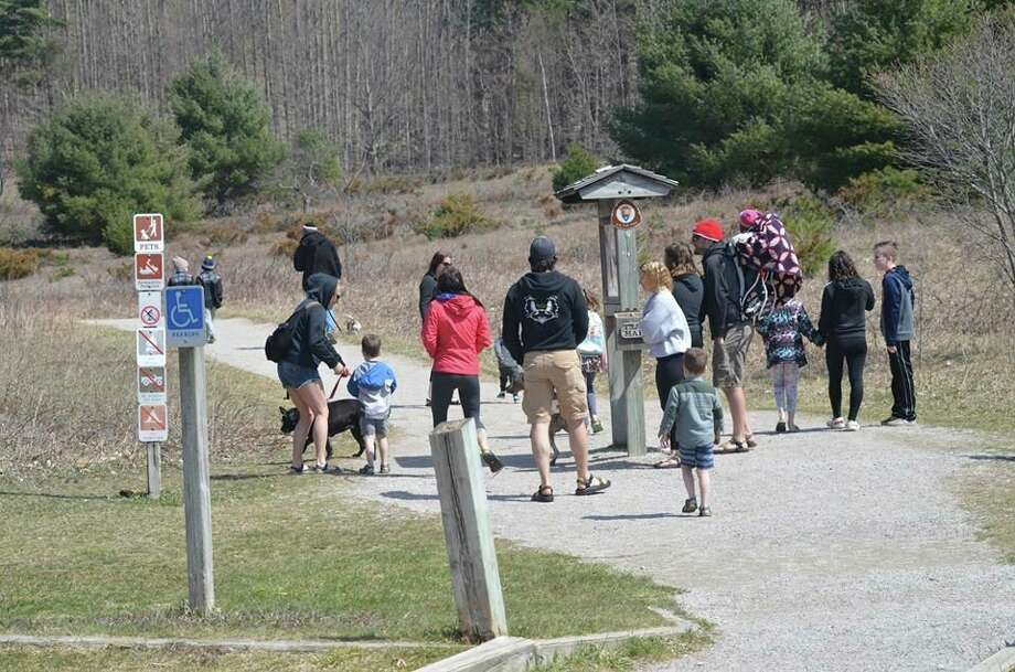A group of people gather on a trail near a trailhead on April 11 in the Sleeping Bear Dunes National Lakeshore.The Sleeping Bear Dunes National Lakeshoreclosedall trails, parking lots and picnic areas until further notice after observing visitors failing to practice social distancing.(Courtesy Photo/Sleeping Bear Dunes National Lakeshore)