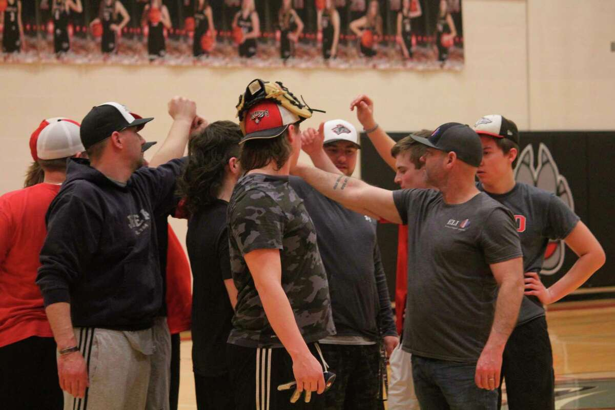 Reed City baseball players close the end of a practice in early March prior to the suspension of the season. (Herald Review file photo)