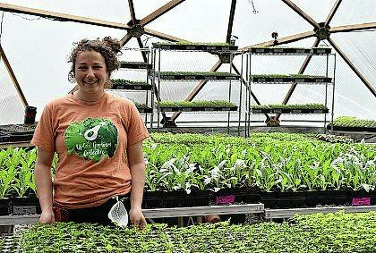 Allison Sturm, urban farm assistant, is seen at the Urban Growers Collective farm in Chicago. The nonprofit teaches young kids and others to grow vegetables at eight urban farms around the city. While their spring educational programs are on hold because of rules on social distancing, co-founder Laurell Sims said they still are focusing on food production and getting produce to families that need it.