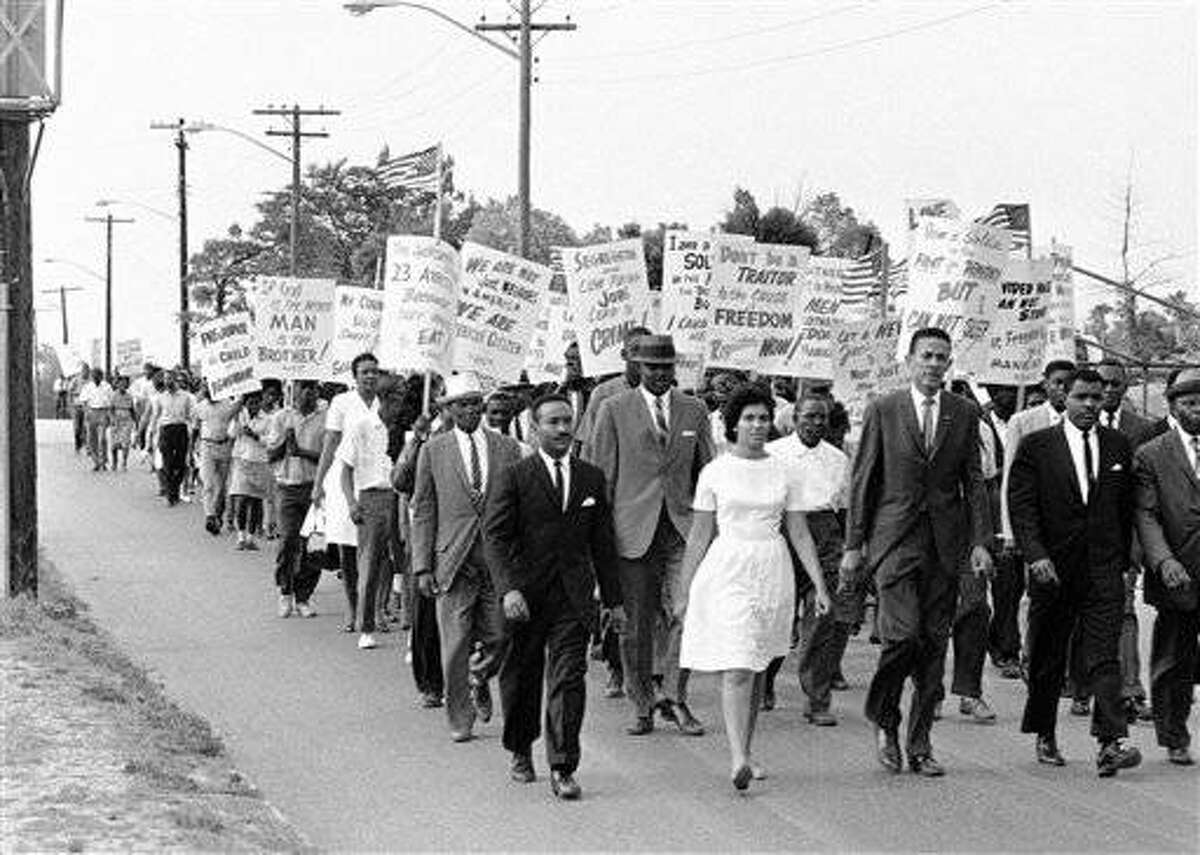 A march to emphasize their integration demands replaced picketing demonstrations for members of the NAACP in Jacksonville, Florida, April 22, 1964. The marchers, with city permission, walked through part of the downtown section during the evening rush hour. There was no violence and very little traffic congestion. (AP Photo/Harold Valentine)
