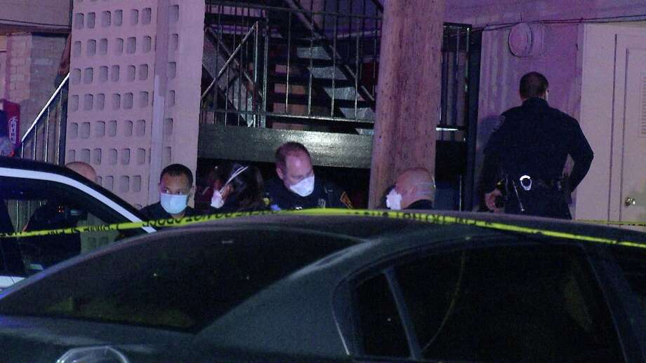San Antonio police are investigatinga shooting in an East Side apartment parking lot Tuesday night after a man was found dead and a second seriously injured. Photo: Ken Branca