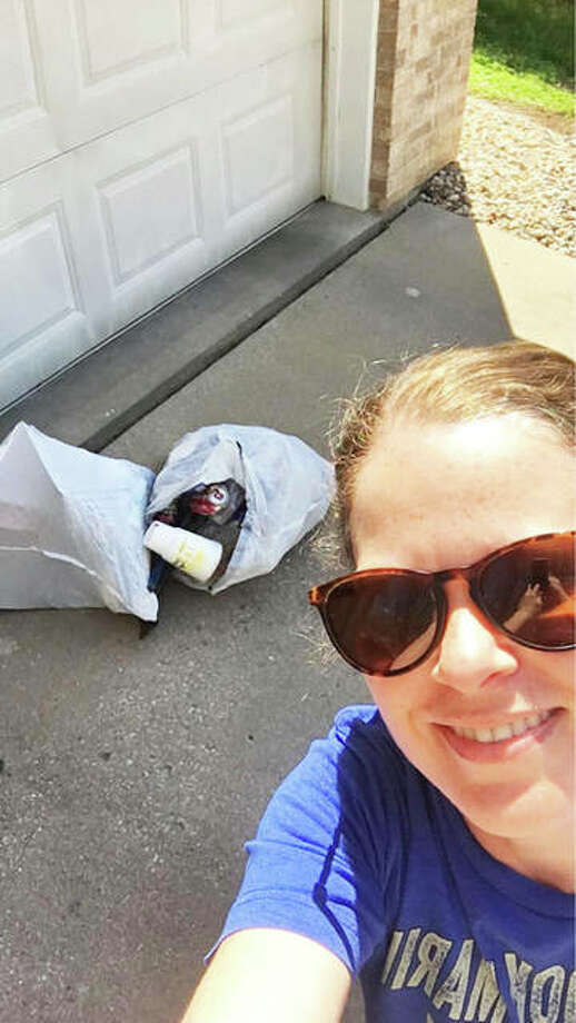 Katie LaPlant‎, a founding member of the public Facebook group, shows two bags of trash collected along a stretch of Seiler Road. The group was formed in lieu of the cancelled Alton City Wide Clean Up, originally scheduled for April 25. Photo: For The Telegraph