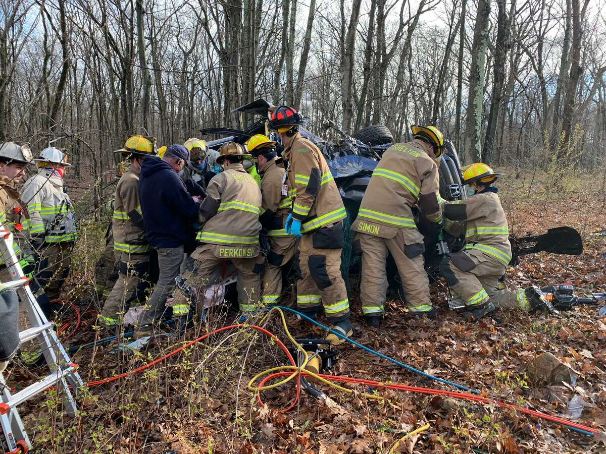 Firefighters work to extricate a person from a rolled over motor vehicle on Buddington Road and L'Hermitage Drive on Tuesday, April 21.