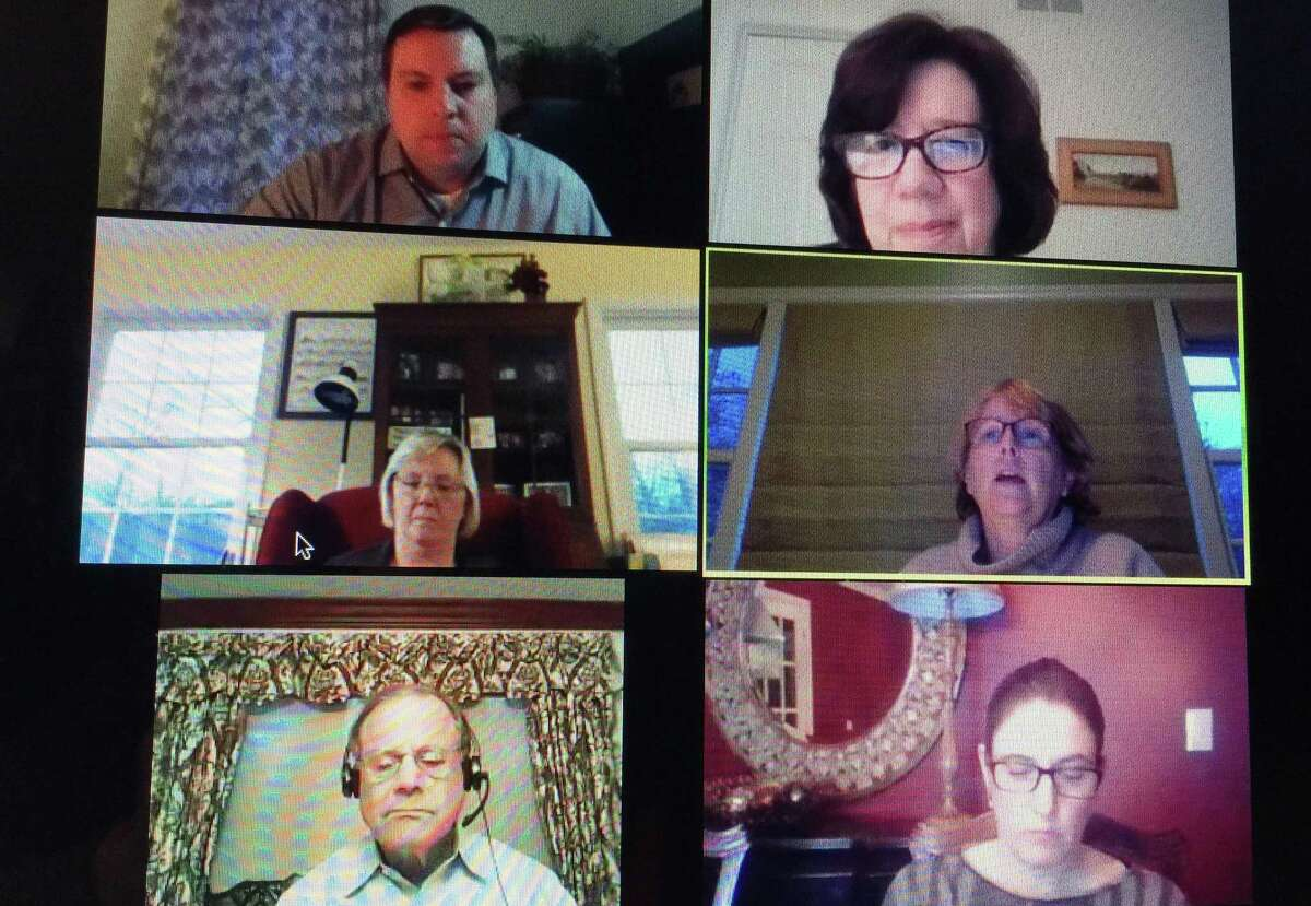 The Wilton Board of Selectmen, clockwise from lower left, Ross Tartell, Deborah McFadden, Josh Cole, Lori Bufano and First Selectwoman Lynne Vanderslice and Chief Financial Officer Ann Kelly-Lenz discuss the budget and tax deferment at a live stream meeting on Tuesday, April 21.