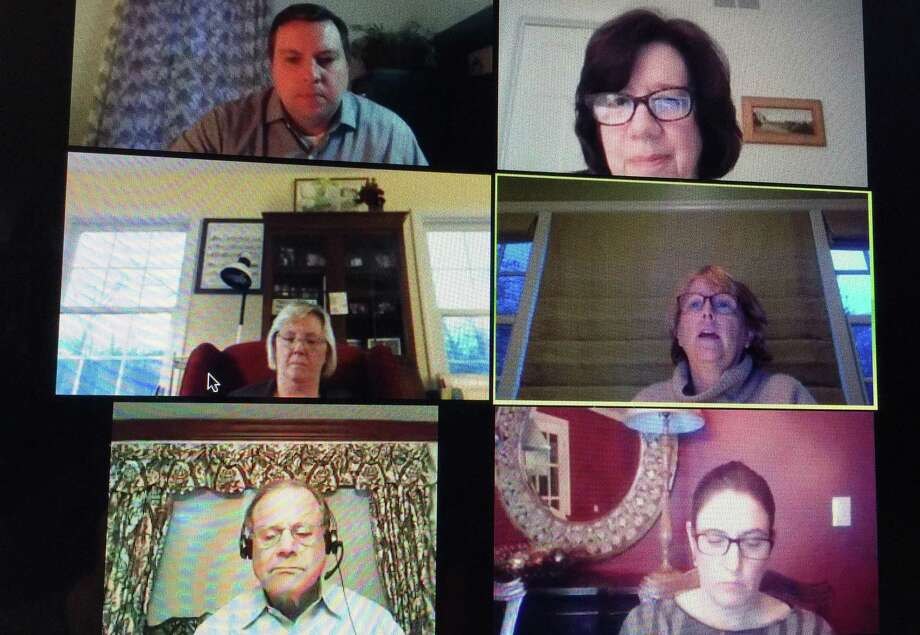 The Wilton Board of Selectmen, clockwise from lower left, Ross Tartell, Deborah McFadden, Josh Cole, Lori Bufano and First Selectwoman Lynne Vanderslice and Chief Financial Officer Ann Kelly-Lenz discuss the budget and tax deferment at a live stream meeting on Tuesday, April 21. Photo: Patricia Gay /Hearst Connecticut Media