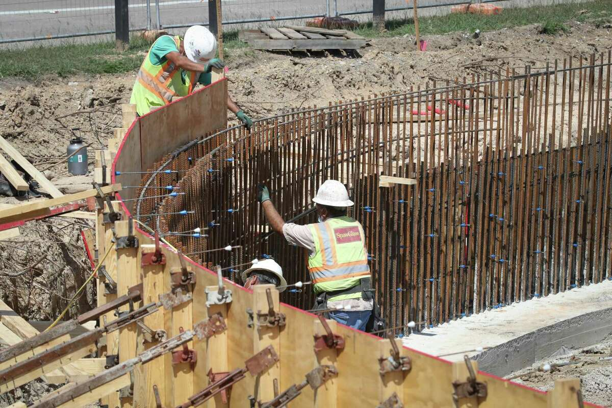 Workers erect a retaining wall at the new Northwest Transit Center on April 21, 2020, near Loop 610 and Interstate 10 north of Uptown.