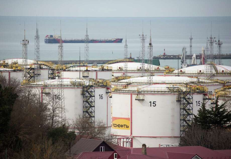 Oil storage tanks stand at the RN-Tuapsinsky refinery as a tanker sails beyond in Tuapse, Russia, on March 23, 2020. Photo: Bloomberg Photo By Andrey Rudakov. / © 2020 Bloomberg Finance LP