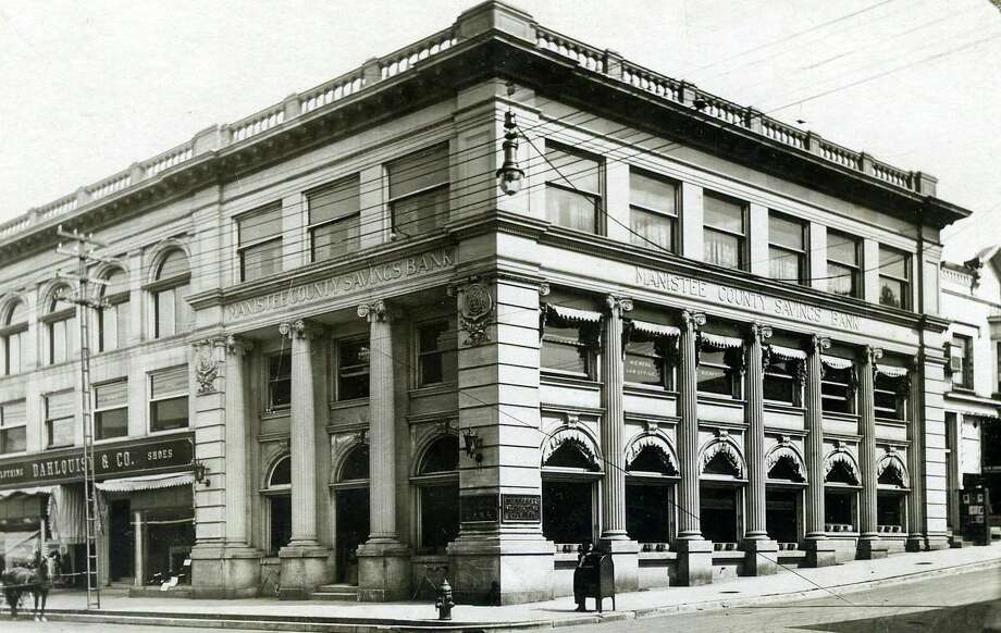 This early 1900 photograph of a building that still exists today shows the Manistee County Savings Bank.