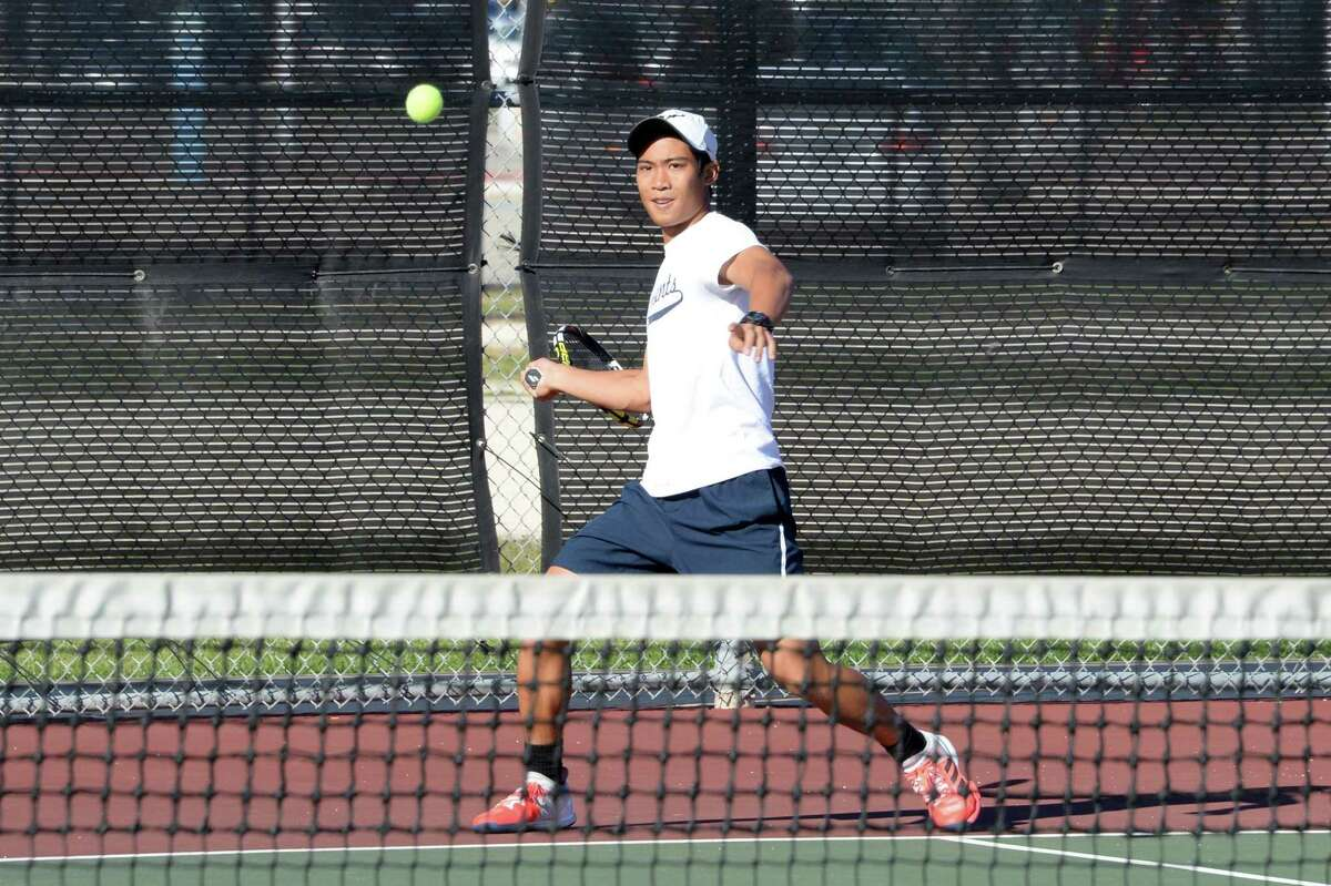 While Katy ISD athletes have lost their seasons in response to the COVID-19 pandemic, the district has reopened its recreational facilities, including tennis courts and tracks. Shown here is a file photo of Fort Bend Clements' Josh Ku hitting a volley in a boys doubles match against Seven Lakes on Oct. 24, 2017, at Seven Lakes High School in Katy.