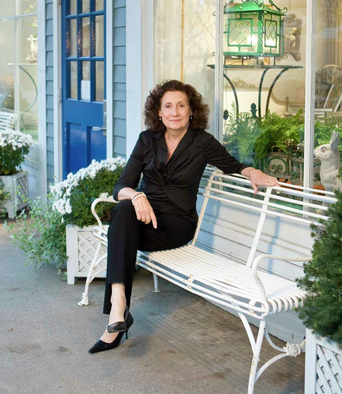 Paulette Peden, owner of Dawn Hill Antiques in New Preston, is photographed in front of her store, which specializes in Swedish interior design furnishings and accessories.