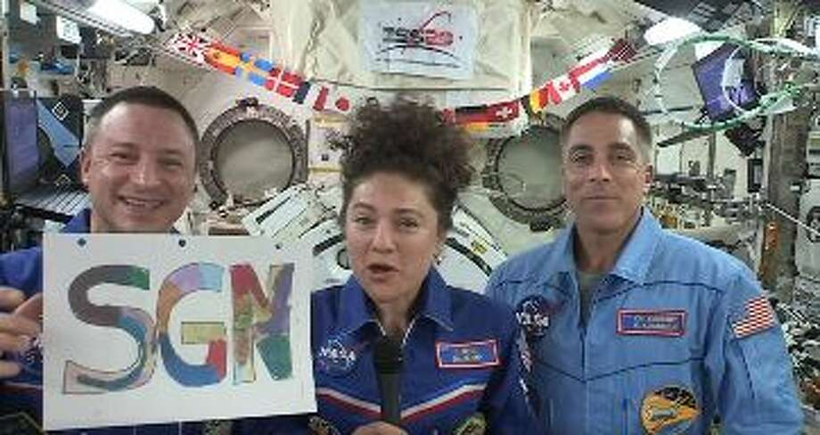 """Astronauts Andrew Morgan, left, Jessica Meir and Chris Cassidy, right, recently made their debut on John Krasinki's """"Some Good News"""" series on Youtube. Photo: Courtesy NASA"""