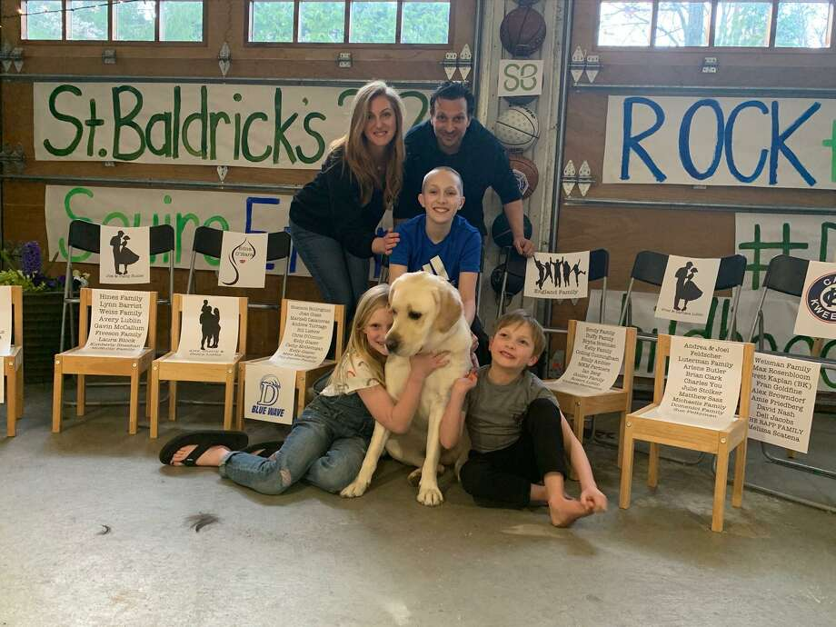 Derek and Kadi Lublin with their children, Ethan, who shaved his head for St. Baldrick's, and his siblings, Liam and Avery, the family dog, Sam. Photo: Contributed /