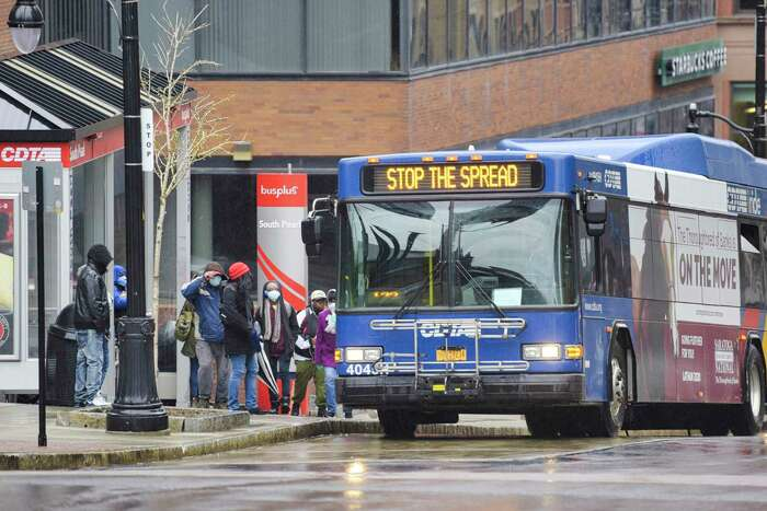 People get on a CDTA bus on State St. on Tuesday, April 21, 2020, in Albany, N.Y. (Paul Buckowski/Times Union)