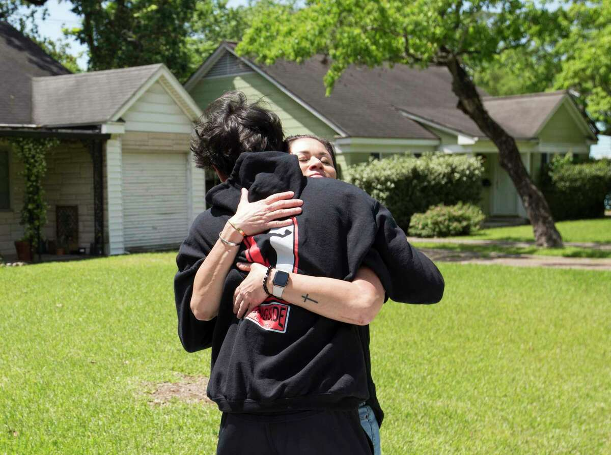 Luke Newman gives his mother, Sylvia Escobedo, a hug has he is going to stay with his father for a week Wednesday, April 15, 2020, at Garden Oaks in Houston. Murray Newman and Escobedo have modified the custody of Luke by alternating weeks during the coronavirus, and both have found the process to be as smooth as it has before the pandemic. Before the pandemic, Newman almost sees Luke everyday while Luke lives with Escobedo.