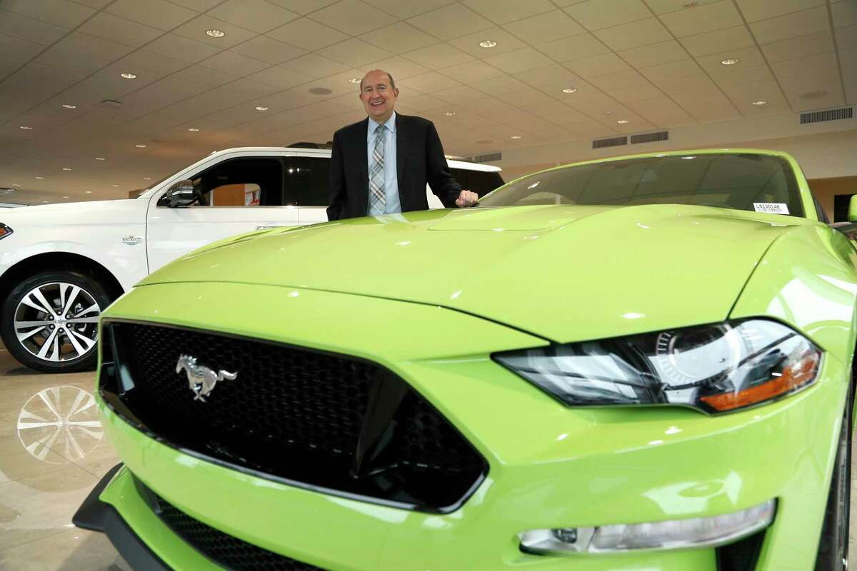 Group 1 Automotive CEO Earl Hesterberg poses in the showroom at Sterling McCall Ford, in Houston, Wednesday, Feb. 5, 2020.