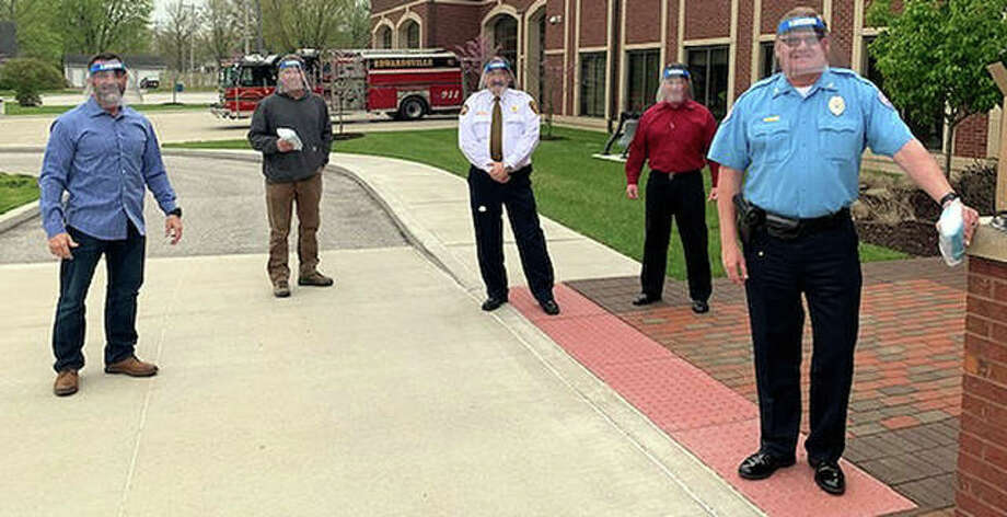 From left and face-shielded are Bryan Speight from MidWest Nonwovens LLC; Mayor Hal Patton; Fire Chief Richard Welle; Jeff Jernigan from Boxing It Up; and Police Chief Jay Keeven. Photo: Courtesy Of City Of Edwardsville