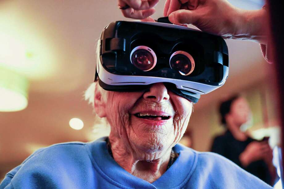 Claris MacConnell, 93, gets a VR headset put on before using the Rendever program at the Sunny View Bay Area Retirement Center on Wednesday, Feb. 12, 2020 in Cupertino, California. Photo: Gabrielle Lurie, Staff / The Chronicle / online_yes