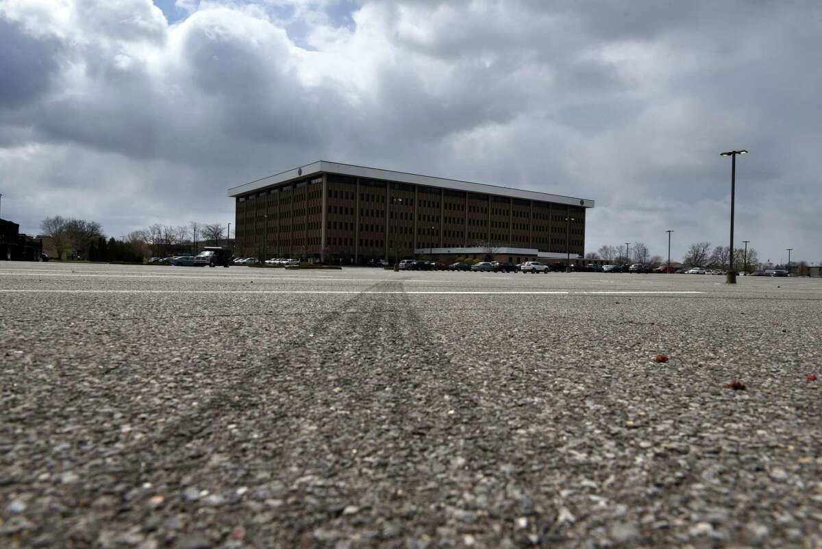 A near-empty parking lot is seen at the New York State Department of Transportation offices on Wednesday, April 22, 2020, on Wolf Road in Colonie, N.Y. Office lots are mostly empty as staff work from home during the coronavirus lockdown. (Will Waldron/Times Union)