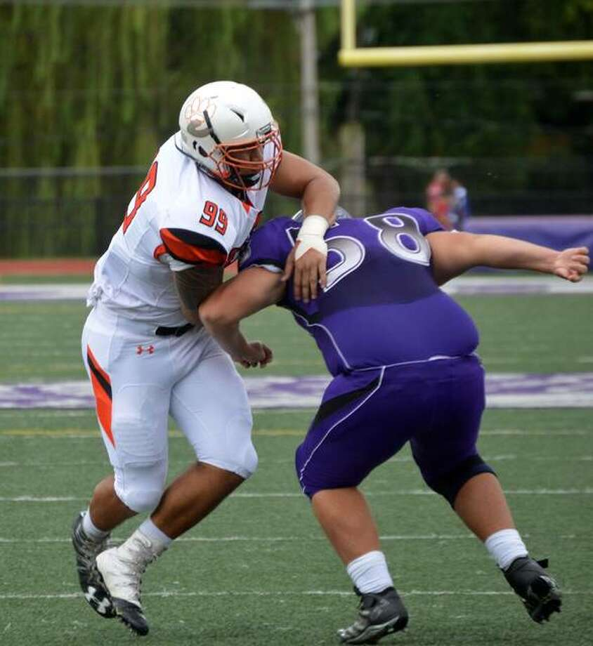 In this file photo, Edwardsville High's A.J. Epenesa moves past a Collinsville offensive lineman during a game his senior season at EHS. Photo: Matt Kamp | For The Telegraph