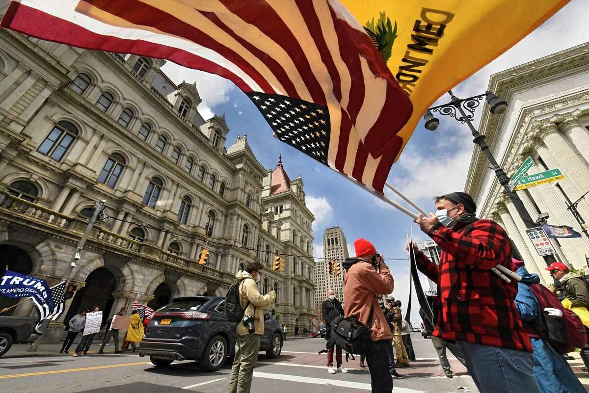 People upset with the state's coronavirus lockdown protest outside the Capitol on Wednesday, April 22, 2020 in Albany, N.Y. Most of the protesters were expressing that they want to go back to work. (Lori Van Buren/Times Union)