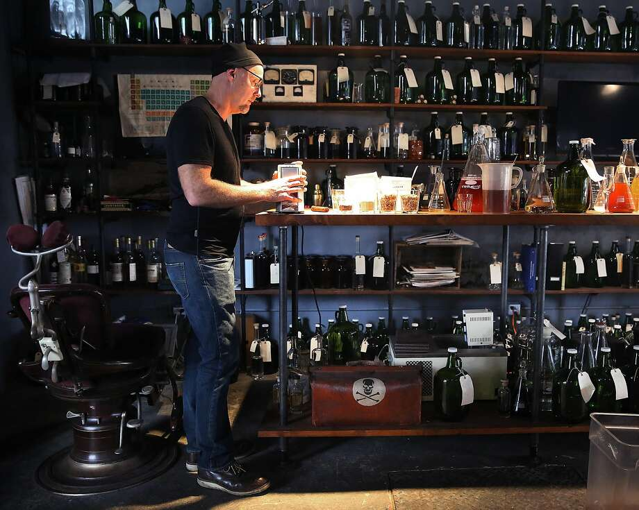 St. George Spirits master distiller Lance Winters, shown here in his laboratory in 2016, says the last five weeks have been like a bad dream but his distillery will be OK. Photo: Liz Hafalia / The Chronicle 2016