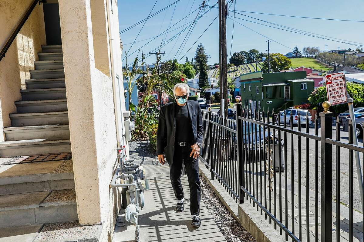 Hany Metwally, who had open heart surgery two weeks ago does his daily walks outside of his home on Wednesday, April 22, 2020 in Oakland, California.