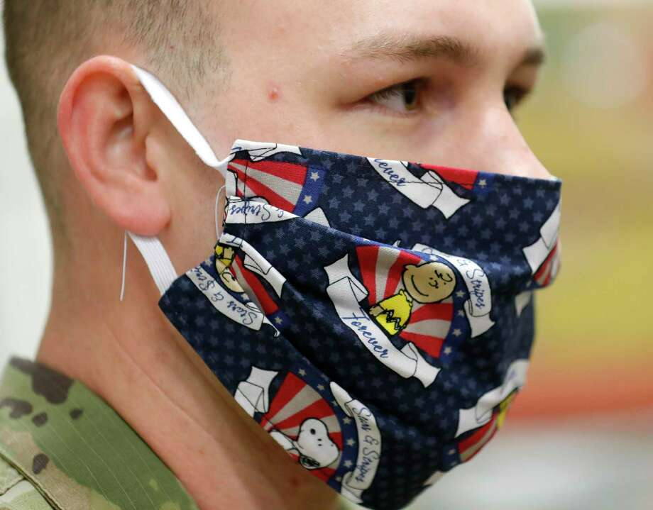 National Guard Lt. Andrew Taylor wears a facemask at the Montgomery County Food Bank, Tuesday, April 21, 2020, in Conroe. Governor Greg Abbott dispatched more than 2,500 guardsmen to serve in varying capacities around the state to help combat COVID-19. Photo: Jason Fochtman, Houston Chronicle / Staff Photographer / 2020 © Houston Chronicle